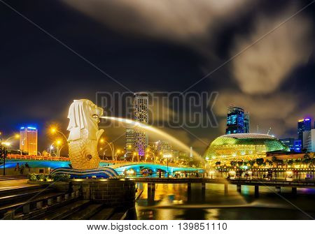 Esplanade And Merlion Statue At Merlion Park At Night