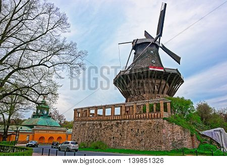 Historic Wind mill in Sanssouci Park in Potsdam in Germany. Sanssouci used to be a summer palace of King of Prussia Frederick the Great. poster