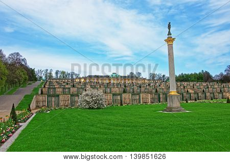 Sculpture and Sanssouci palace and garden terrace in Sanssouci Park in Potsdam in Germany. A summer palace of King of Prussia Frederick the Great. poster