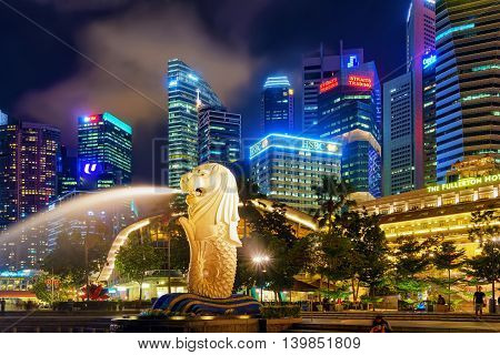 Skyscrapers And Merlion Statue At Merlion Park At Night