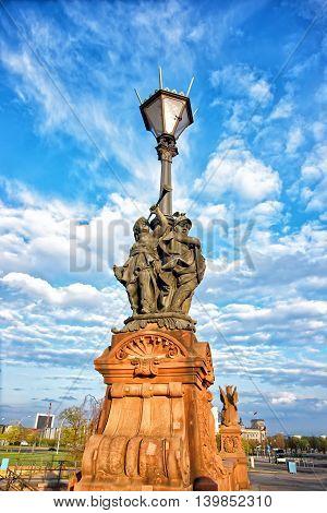 Street Lamp On Moltke Bridge Over Spree River In Berlin