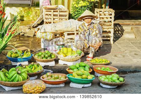 Asian Trader Selling Fresh Bananas Mango And Lime