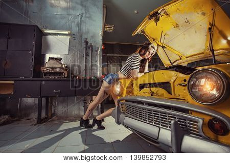 Woman Mechanic In Sexy Shirts Is Thinking How To Repair An Old Car.