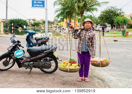 Asian Woman Greengrocer Carrying Rambutan Mango Banana And Mandarin