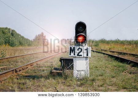 Shunting light shines a red light on the railway