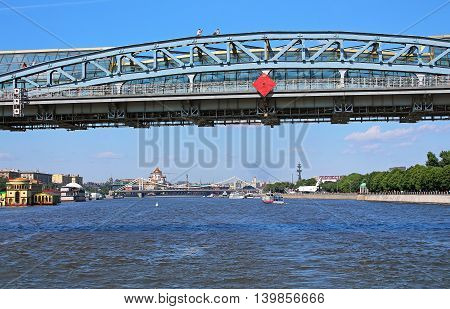 MOSCOW, RUSSIA - JUNE 05 ,2013: Moscow river and Pedestrian Andreevsky bridge in Moscow, Russia. The name ofbridge refers to a historical bridge demolished in 1998 and three existing bridges across Moskva River, located between Luzhniki and Gorky Par