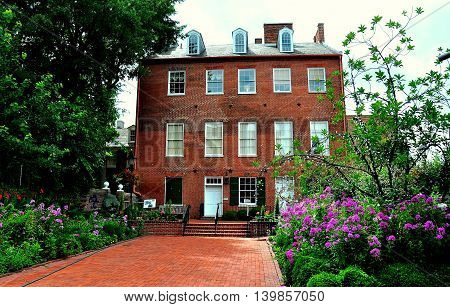 Baltimore Maryland - July 23 2013: Historic 1811 Carroll Mansion and gardens at 800 East Lombard Street built by Charles Carroll a signer of the Declaration of Independence *