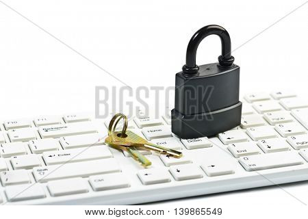 Data security concept with padlock and key on computer keyboard over white