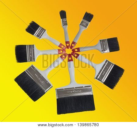 Paint brush composition on yellow and orange background