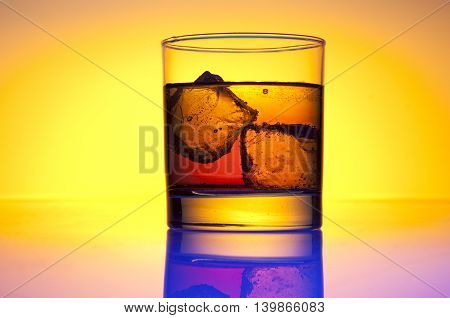 a glass of whiskey in a glass