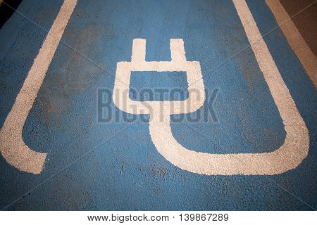 Color image of a parking spot for electric cars.