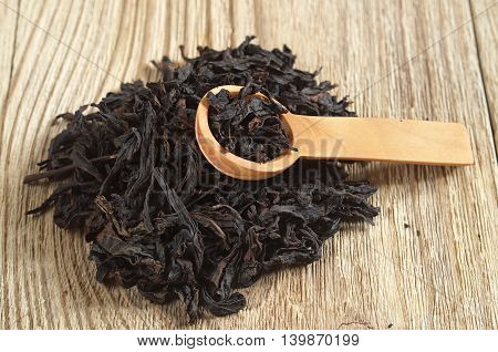 Chinese oolong tea dahongpao on wooden background