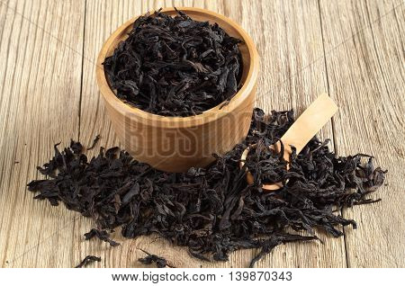Chinese oolong tea dahongpao in bowl on wooden background