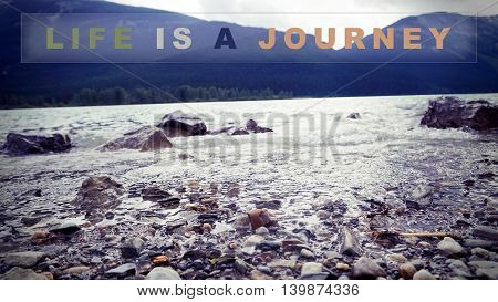 Life is a journey : quote on nature background