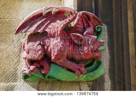 CAMBRIDGE UK - JULY 18TH 2016: A close-up of a small sculpture on the exterior of Christ's College in Cambridge on 18th July 2016.
