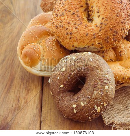 Freshly baked bread and buns on wooden background