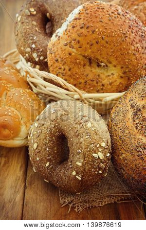 Fresh bread and buns on wooden background