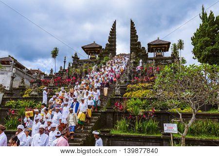 BALI INDONESIA - APRIL 26: Prayers in Pura Besakih Temple on April 26, 2016 in Bali Island, Indonesia.