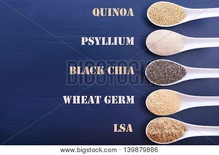 Assorted Grains On Dark Wood Table.