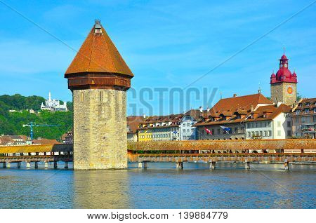 Morning view of Kapellbrucke in the historical city center. Luzern. Switzerland.