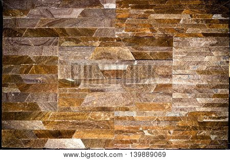 The Texture Of A Wall Of Slate, Travertine, Marble And Granite