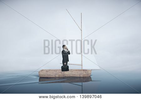 Wooden sailing boat with thoughtful businessman on water. Dull sky background. Research concept. 3D Rendering
