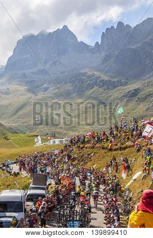 Col du Glandon France - 23 July 2015: The peloton riding in a beautiful curve at Col du Glandon in Alps during the stage 18 of Le Tour de France 2015.