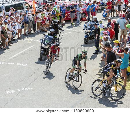 Col du Glandon France - July 23 2015: Serge Pauwels of MTN-Qhubeka TeamPierre Rolland of Europcar Team and Damiano Caruso of BMC Racing Team riding in a beautiful curve at Col du Glandon in Alps during the stage 18 of Le Tour de France 2015.