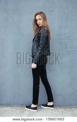 Happy Young Beautiful Woman In Black Leather Jacket Black Jeans Slip-on Posing For Model Tests Again