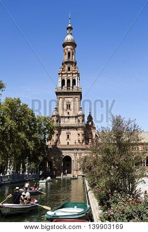 SEVILLE, SPAIN - September 13, 2015: Boats near the northern tower of the Plaza de Espana (Spain Square) on September 13, 2015 in Seville, Spain