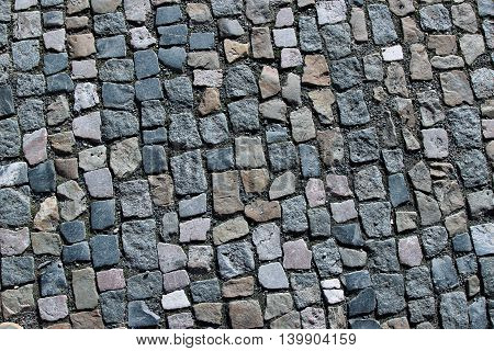 Background of the granite paving in Prague