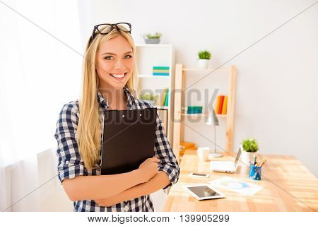 Young Businesswoman In Glasses Holding Document Case With Contracts