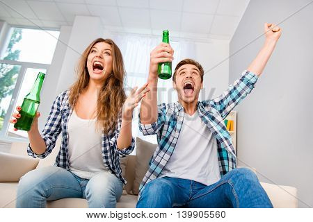 Goal! Happy Man And Woman With Beer Triumphing With Raised Hands