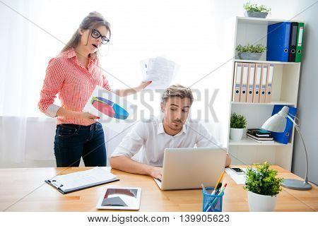 Angry Frustrated Woman Screaming At Her Partner For Bad Work