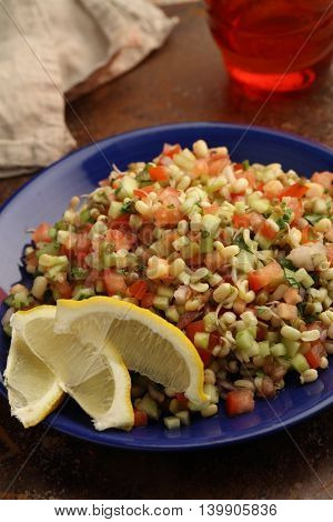 Tabbouleh salad with mung bean sprouts, lemon, and vegetables