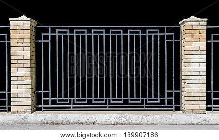 metal fence with brick pillars Black background