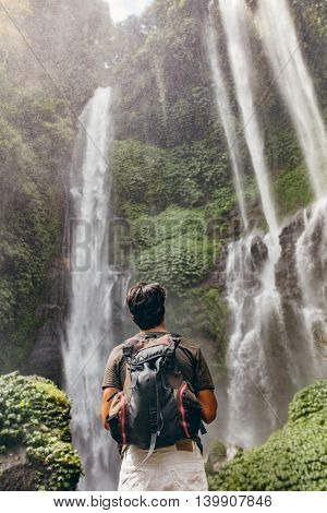 Male Hiker Looking At Waterfall