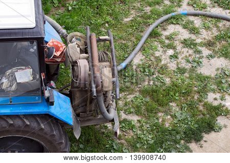 Tractor with a water pump and hose