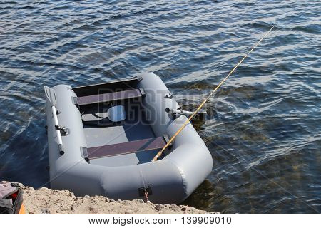 Rubber boat on coast of lake
