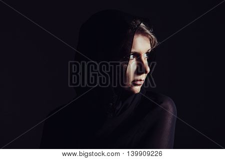 Portrait Of Beautiful Woman With Brown Eyes Wearing Black Scarf