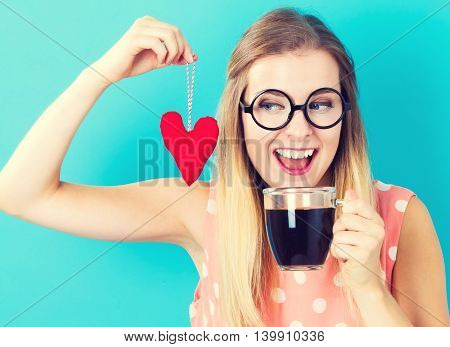 Woman Drinking Coffee With A Heart Cushion