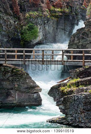 Saint Mary Falls and Bridge in Montana mountains