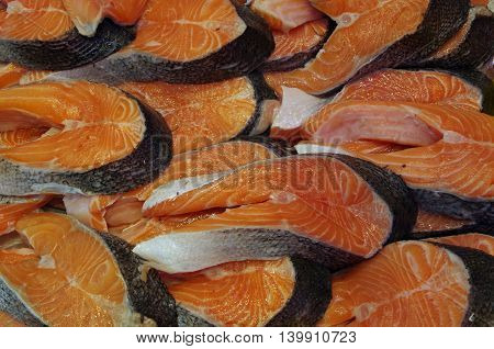 Salmon steaks with skin piled for market