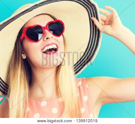 Happy Woman Wearing A Hat And Sunglasses
