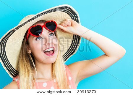 Happy Young Woman Wearing A Red Heart Sunglasses