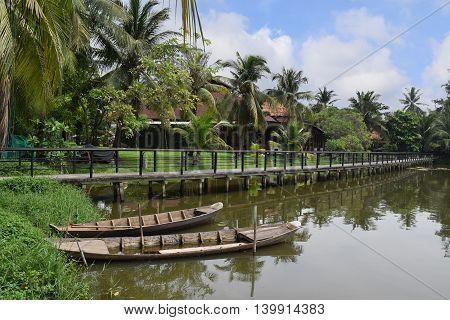 rural village with traditional boat bridge in Van Thanh ho chi minh city vietnam