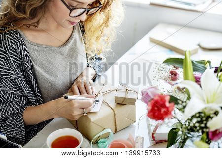 Female Writing Thankyou Card Present Concept