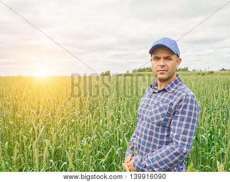 Farmer In Plaid Shirt Controlled His Field.