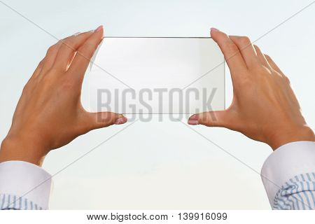 The girl looks at a virtual screen of your smartphone