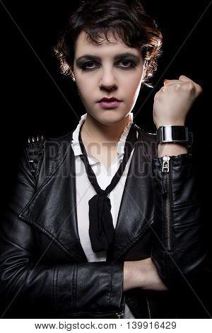 Fashionable depiction of wearable tech smart watch on a punk rock female model